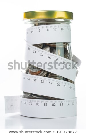 Rolling deposit money by Measuring tape  Stock photo © hin255