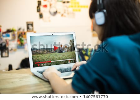 girl watching videos on tablet stock photo © stokkete