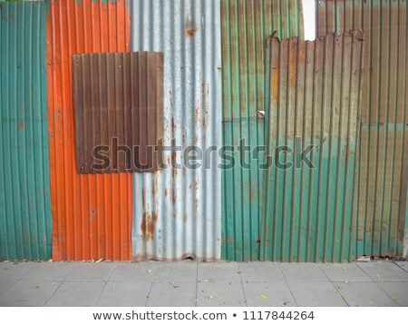 Rusty corrugated iron and brick wall background Stock photo © lucielang