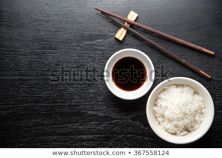 Kom rijst eetstokjes voedsel hout Stockfoto © tilo