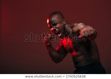 Lutteur posant caméra boxe noir sexy Photo stock © ralanscott