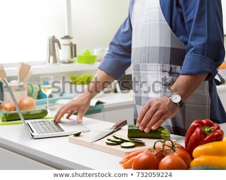 Home food cooking online recipes with laptop Stock photo © LoopAll