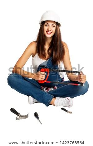 pretty woman with hacksaw stock photo © fouroaks