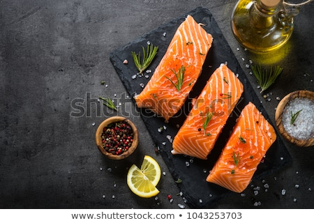raw salmon fish fillet with lemon spices and fresh herbs stock photo © kayco