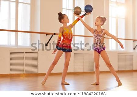 Küçük jimnastikçi top beyaz çocuk Stok fotoğraf © Discovod