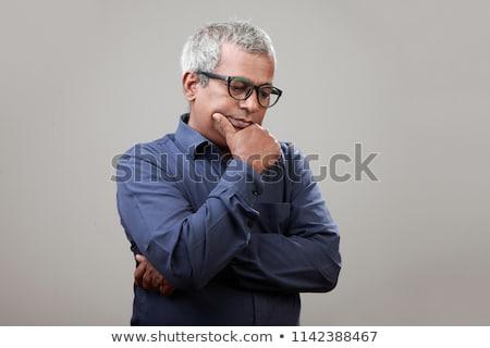 Shocked mature Indian businessman Stock photo © szefei