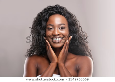 woman with fresh skin looking at camera stock photo © deandrobot