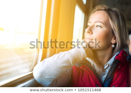 young woman looks in train`s window stock photo © Paha_L
