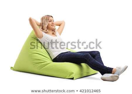 girl on beanbag stock photo © hasloo