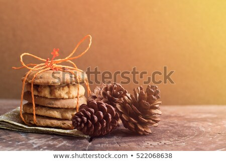 tiny light cookies on old wooden table stock photo © dariazu