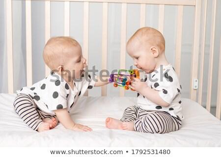twee · zusters · tweelingen · slapen · slaapkamer · samen - stockfoto © deandrobot