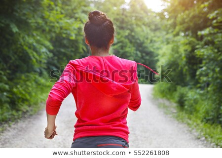 Young lady runner on a rural road in the morning Stock photo © dashapetrenko