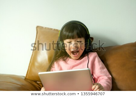 Young pretty girl watching something stock photo © konradbak