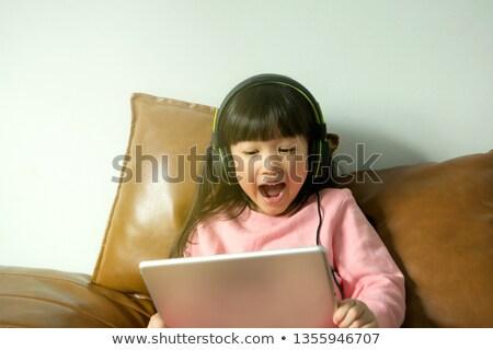 Сток-фото: молодые · довольно · девушки · смотрят · что-то · компьютер