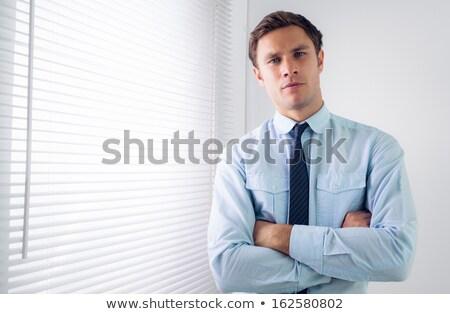 stern businessman in blue shirt portrait Stock photo © Giulio_Fornasar