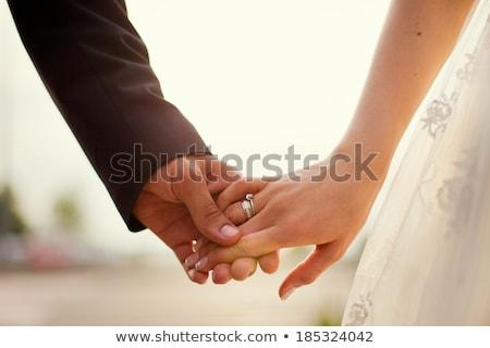 férj · feleség · tart · virágok · csók · mosolyog - stock fotó © monkey_business