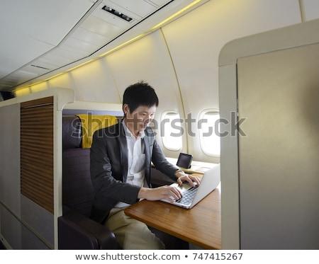 Stock fotó: üzletember · dolgozik · üzlet · osztály · fülke · légi · közlekedés
