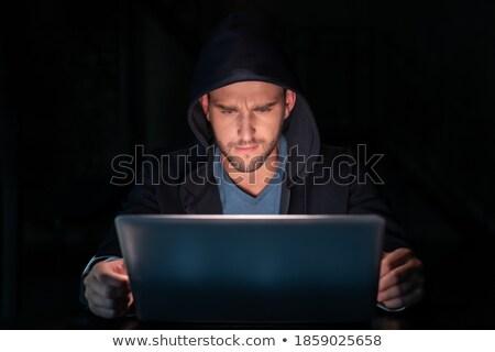 Centrado hombre escribiendo portátil negro pelo Foto stock © wavebreak_media