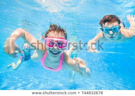 Csoport úszik vízalatti nő férfi sport Stock fotó © IS2
