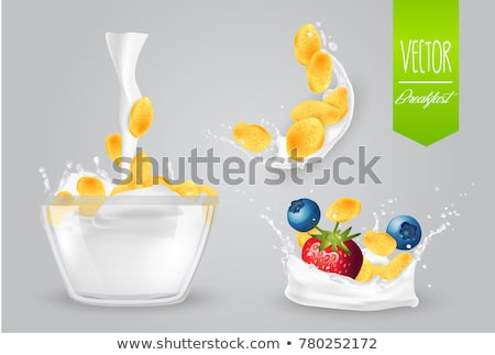 Corn flakes and glass of milk Stock photo © ajfilgud