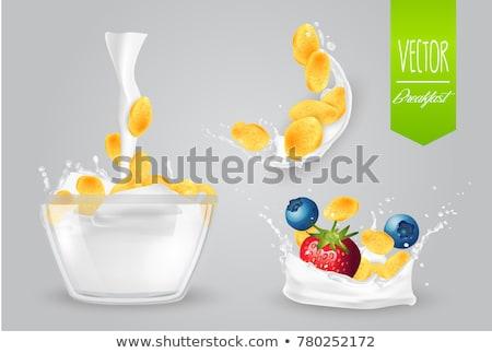 Corn flakes and glass of milk stock photo © ajfilgud