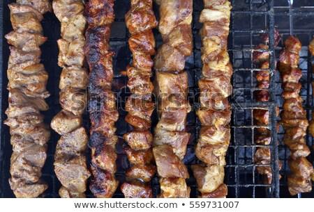 Shashlik roasting on hot grill, one piece scorched. Stock photo © Valeriy
