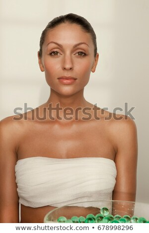 Woman sitting with bowl of glass beads Stock photo © IS2