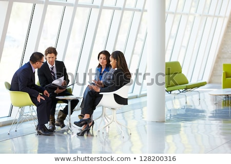 Businessman and businesswoman sitting in a meeting in the conference room Stock photo © wavebreak_media