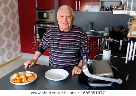Gray wear man cooking Stock photo © toyotoyo
