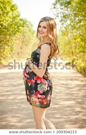 Cute Pregnancy Woman in Beautiful Green Dress Stock photo © robuart