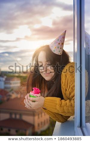 sad lonely woman on her birthday holding cupcake stock photo © dashapetrenko