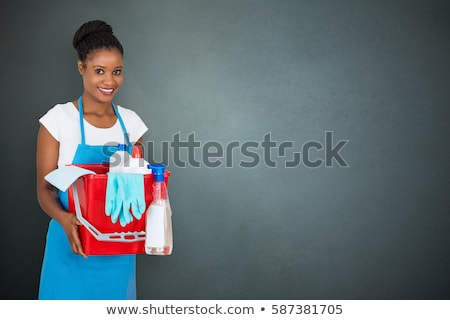 Smiling Female Janitor Holding Cleaning Equipment Stock photo © AndreyPopov