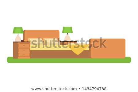 wooden bed between cubic bedside tables with lamps stock photo © robuart