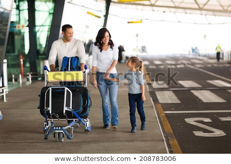 Woman with Trolley full of Baggage at Airport Stock photo © robuart