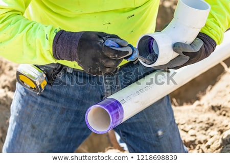 Plumber Applying Pipe Cleaner, Primer and Glue to PVC Pipe At Co Stock photo © feverpitch