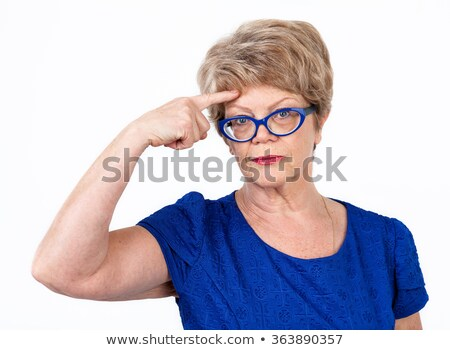 Woman touching her forehead with finger Stock photo © Kzenon