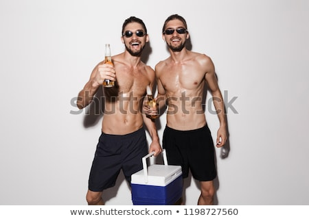 Portrait of a two excited muscular shirtless twin brothers Stock photo © deandrobot