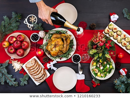 Stock photo: Christmas table setting with wine and xmas tree