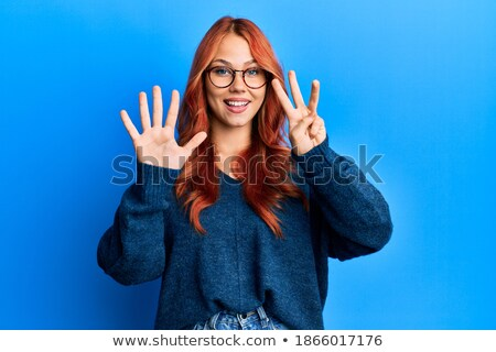 A girl showing number eight Stock photo © colematt