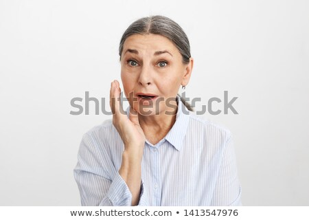 Shocked woman with big eyes and hand mouth in studio stock photo © studiolucky