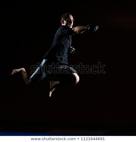 Adam siyah tshirt el atlamak spor Stok fotoğraf © Andreyfire
