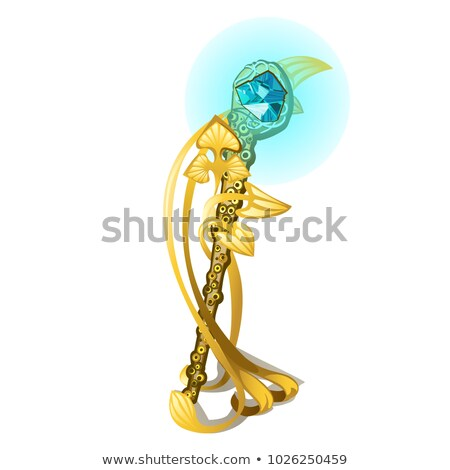 Souvenir in the shape of a golden magic wand in the form of the tentacles of the mollusk with a prec Stock photo © Lady-Luck