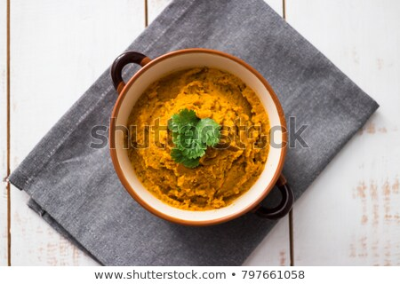 dipping carrot in a homemade hummus Stock photo © nito