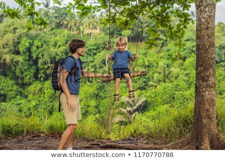 Dad and son on the Swing at the Campuhan Ridge Walk in Ubud, Bali Stock photo © galitskaya