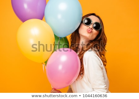 Pleased lovely brunette woman in sweater sends air kiss Stock photo © deandrobot