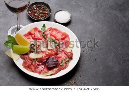 marbled beef carpaccio and red wine stock fotó © karandaev