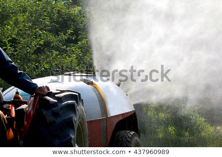 Tractor spraying insecticide or fungicide in apple orchard  Stock photo © simazoran