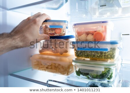 mans hand taking container of mixed vegetables stock photo © andreypopov