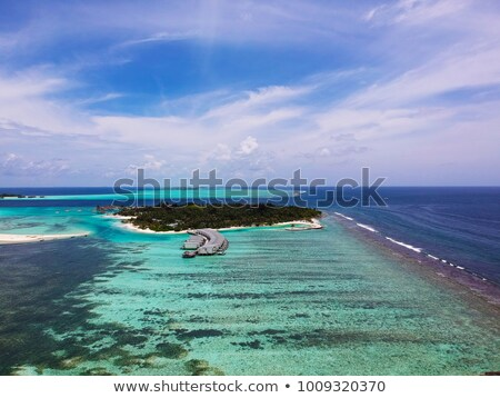 Travel vacation paradise aerial image with overwater bungalows in coral reef sea Stock photo © Maridav