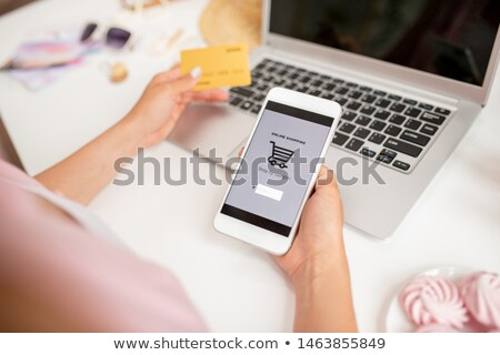 Smartphone held by young contemporary mobile shopper searching for goods Stock photo © pressmaster